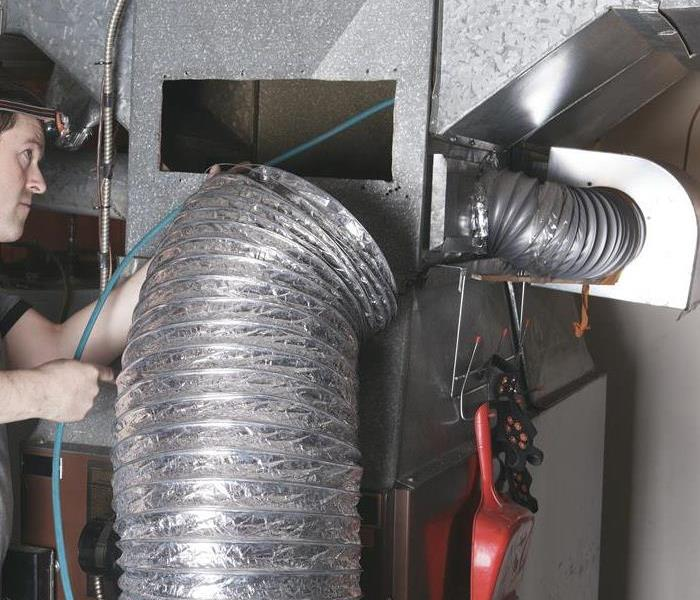 Duct work with technician inspecting