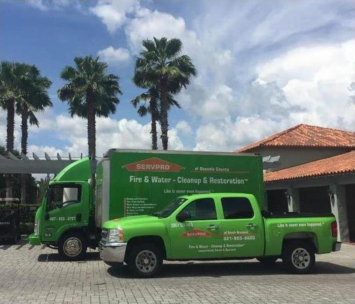 SERVPRO green trucks in front of business building