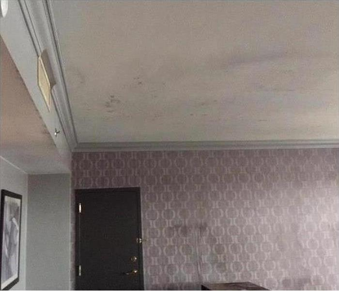 Damage caused to the ceiling due to fire sprinklers flooding